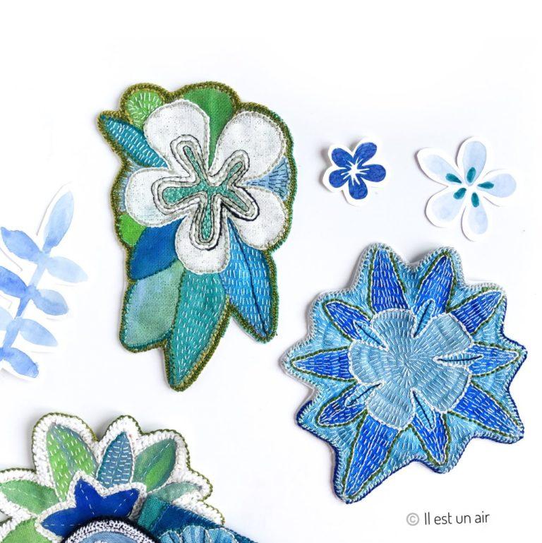 deco de mur textile : fleurs peintes et brodées